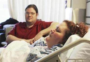 Her husband, Stewart Schroeder, keeps watch over her at the hospital.